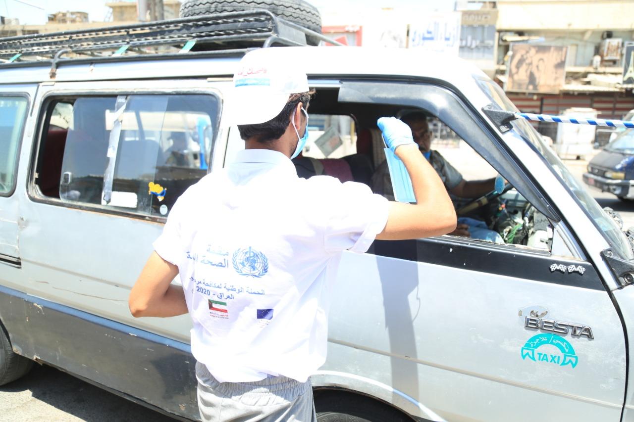 """بالصور .. الصحة العالمية تواصل حملتها لمكافحة """"كورونا"""" في مدينة الصدر"""